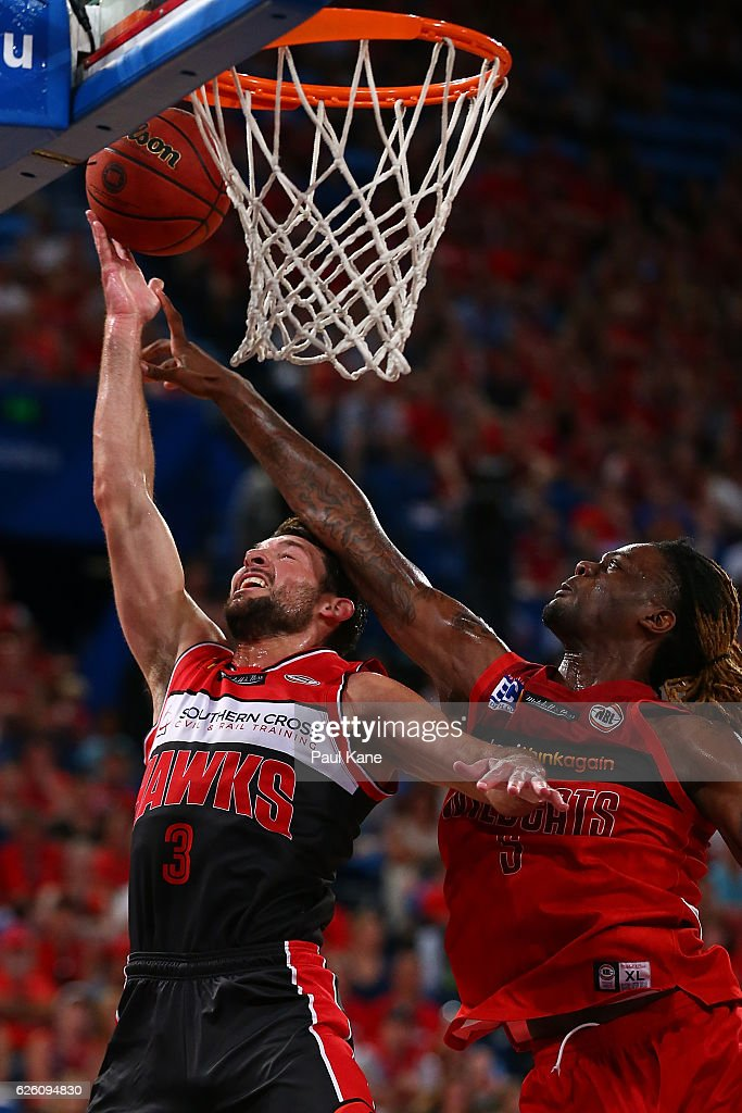 Kevin White of the Hawks lays up against Jameel McKay of the Wildcats during the round eight NBL match between the Perth Wildcats and the Illawarra Hawks at the Perth Arena on November 27, 2016 in Perth, Australia.