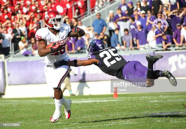 Kevin White of the TCU Horned Frogs reaches for Zack Sanchez of the Oklahoma Sooners at Amon G Carter Stadium on December 1 2012 in Fort Worth Texas
