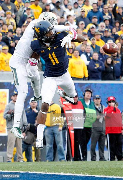 Kevin White of the West Virginia Mountaineers attempts to make a catch during the game against the Baylor Bears on October 18 2014 at Mountaineer...