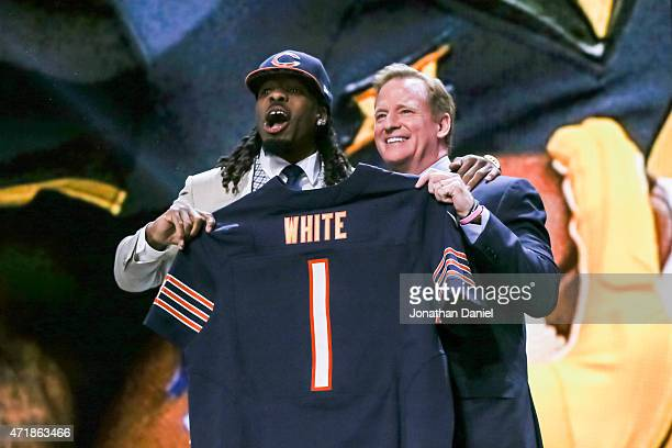 Kevin White of the West Virginia Mountaineers holds up a jersey with NFL Commissioner Roger Goodell after being chosen overall by the Chicago Bears...