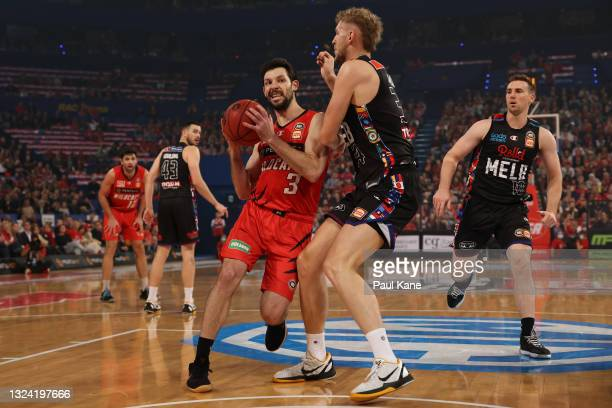 Kevin White of the Wildcats drives to the basket against Jock Landale of Melbourne United during game one of the NBL Grand Final Series between the...
