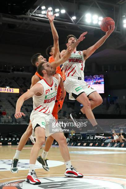 Kevin White of the Wildcats drives to the basket during the NBL Cup match between the Cairns Taipans and the Perth Wildcats at John Cain Arena on...