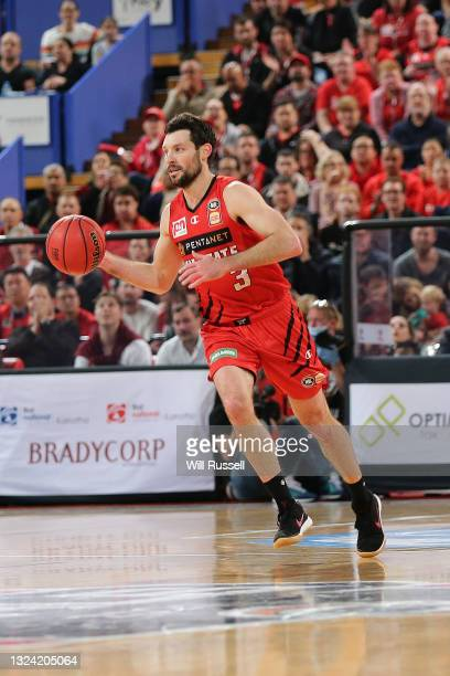 Kevin White of the Wildcats passes the ball during game one of the NBL Grand Final Series between the Perth Wildcats and Melbourne United at RAC...