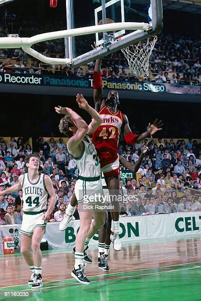 Kevin Willis of the Atlanta Hawks shoots a layup against Larry Bird of the Boston Celtics during a game played in 1987 at the Boston Garden in Boston...