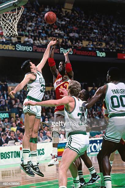 Kevin Willis of the Atlanta Hawks shoots againest Kevin McHale of the Boston Celtics during a game played in 1988 at the Boston Garden in Boston...