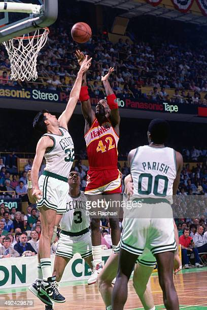 Kevin Willis of the Atlanta Hawks shoots against Kevin McHale of the Boston Celtics during a game played in 1988 at the Boston Garden in Boston...