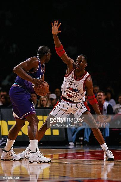 Kevin Willis of the Houston Rockets guards Antoine Carr of the Utah Jazz during the game on January 10 1998 at the Compaq Center in Houston Texas The...