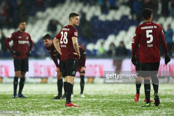 Kevin Wimmer and Felipe of Hannover 96 look dejected after defeat in the Bundesliga match between Hannover 96 and Bayer 04 Leverkusen at HDIArena on...