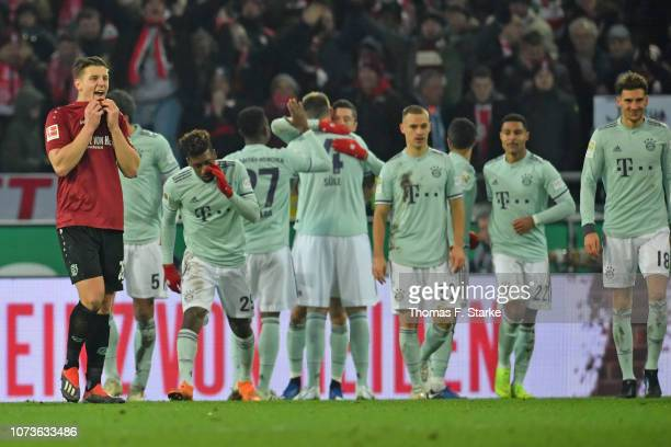 Kevin Wimmer of Hannover looks dejected while players of Muenchen celebrate their fourth goal during the Bundesliga match between Hannover 96 and FC...