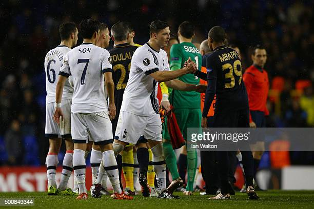 Kevin Wimmer of Spurs shakes hands with Kylian MbappeLottin of Monaco following the final whistle during the UEFA Europa League Group J match between...