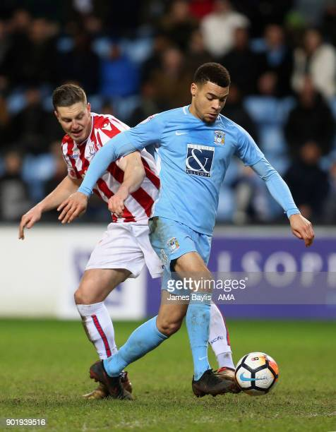 Kevin Wimmer of Stoke City and Maxime Biamou of Coventry City during The Emirates FA Cup Third match between Coventry City and Stoke City at Ricoh...