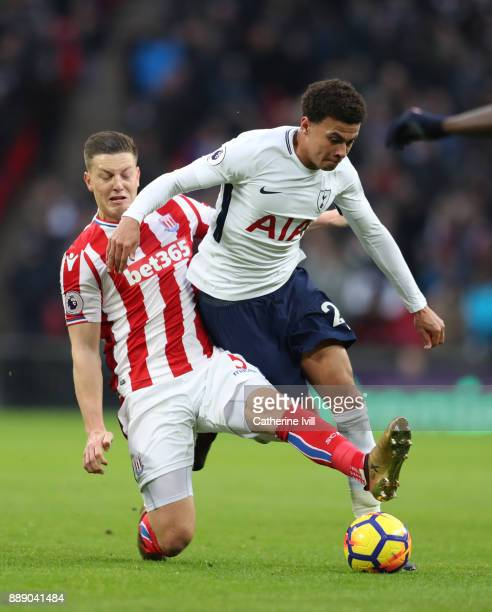 Kevin Wimmer of Stoke City tackles Dele Alli of Tottenham Hotspur during the Premier League match between Tottenham Hotspur and Stoke City at Wembley...