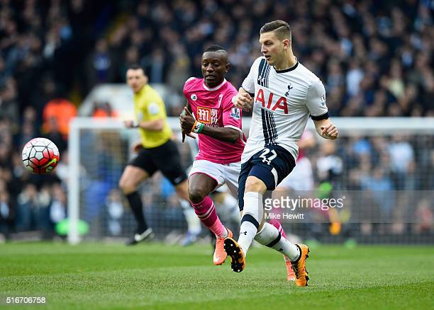 Kevin Wimmer of Tottenham Hotspur clears the ball from Max Gradel of Bournemouth during the Barclays Premier League match between Tottenham Hotspur...
