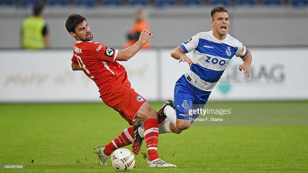 Kevin Wolze (R) of Duisburg and Florian Dick of Bielefeld fight for the ball during the Third League match between MSV Duisburg and Arminia Bielefeld at Schauinsland-Reisen-Arena on August 27, 2014 in Duisburg, Germany.