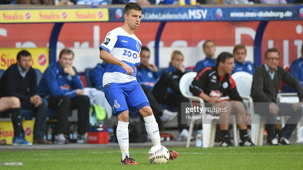 Kevin Wolze of Duisburg runs with the ball during the Third League match between MSV Duisburg and Arminia Bielefeld at Schauinsland-Reisen-Arena on August 27, 2014 in Duisburg, Germany.