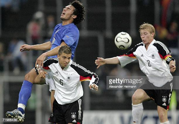 Kevin Wolze of Germany competes with Fabio Zamblera of Italy during the Men's Under 17 Four Nation Tournament between Germany and Italy at the Wald...