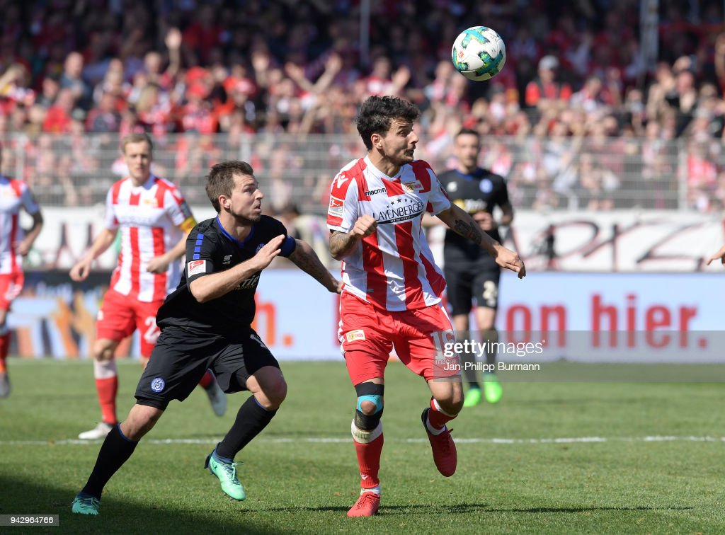 Kevin Wolze of MSV Duisburg and Philipp Hosiner of 1 FC Union Berlin during the 2nd Bundesliga game between Union Berlin and MSV Duisburg at Stadion an der alten Foersterei on April 7, 2018 in Berlin, Germany.