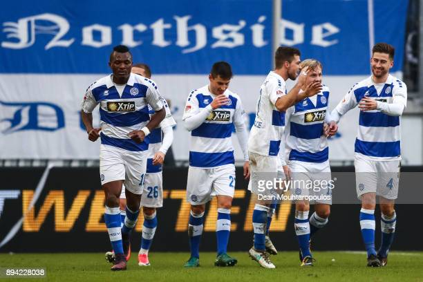Kevin Wolze of MSV Duisburg celebrates with his teammates after scoring his team's second goal to make it 20 during the Second Bundesliga match...