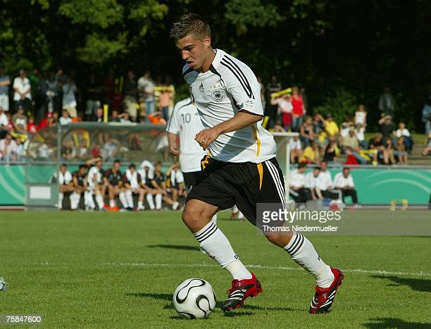 Kevin Wolze of the German national soccer team runs with the ball during their U 17 match against the national team of Togo at the Allgaeustadion on...