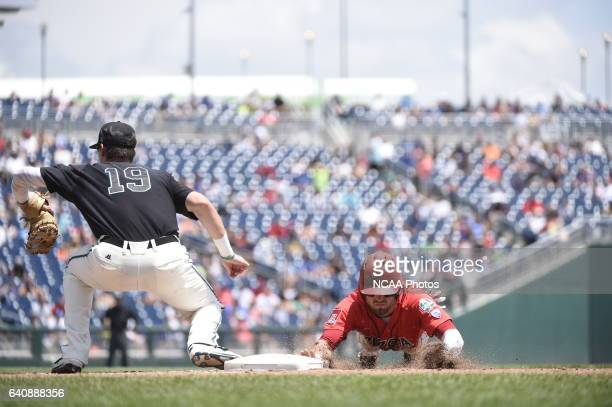 Kevin Woodall Jr of Coastal Carolina University awaits the ball from the pitcher on a pickoff move against the University of Arizona during Game 3 of...