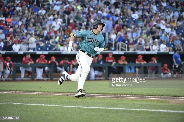 Kevin Woodall Jr of Coastal Carolina University hustles around first base for a double against the University of Arizona during the Division I Men's...