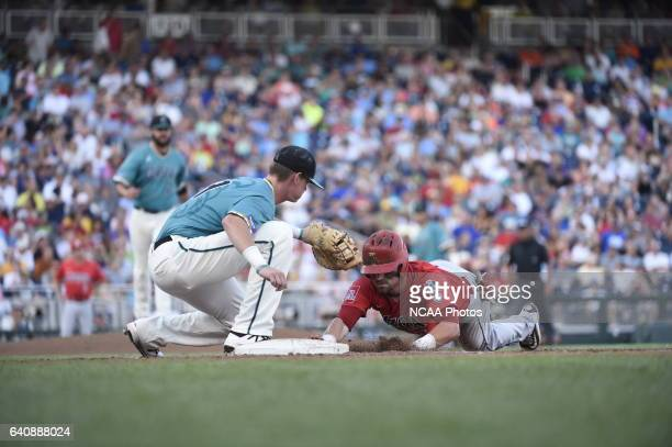 Kevin Woodall Jr of Coastal Carolina University receives the ball during a pickoff move against University of Arizona during the Division I Men's...