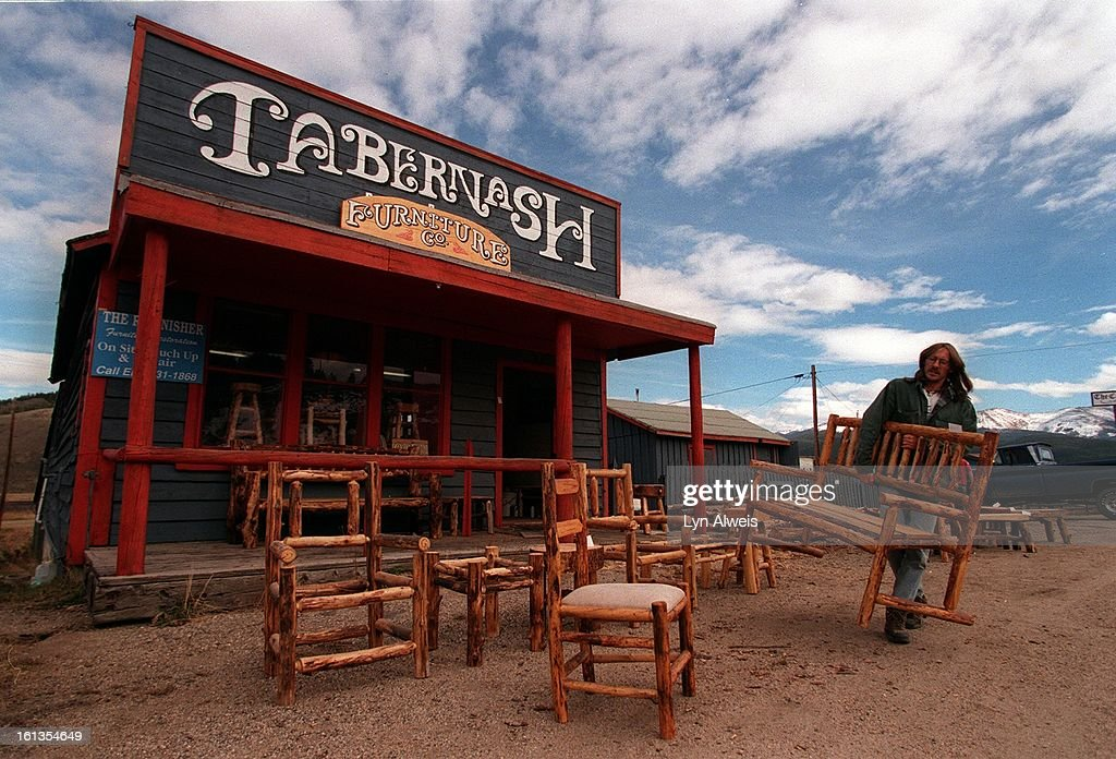 Kevin Woolley (cq) Owner Of Tabernash Furniture Co. On Colorado Highway 40  In Tabernash, Colorado, Arranges Rustic Furniture In Front Of His Workshop  To ...