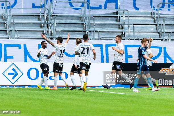 Kevin Wright of Orebro SK celebrates scoring the 1-1 equalizing goal with teammates during an Allsvenskan match between Djurgardens IF and Orebro SK...