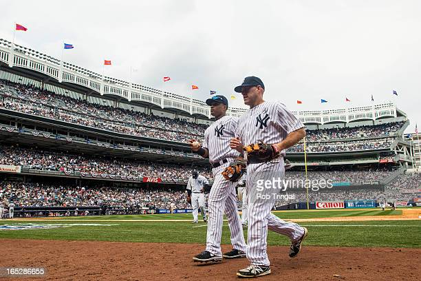 Kevin Youkilis and Robinson Cano of the New York Yankees are seen during the Opening Day game against the Boston Red Sox on Monday April 1 2013 at...