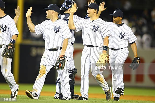 Kevin Youkilis Mark Teixeira and Mariano Rivera of the New York Yankees celebrate a 43 win against the Cleveland Indians during their game on June 4...