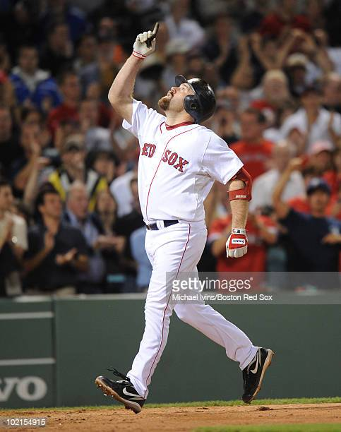 Kevin Youkilis of the Boston Red Sox celebrates after hitting a tworun home run against the Arizona Diamondbacks in the seventh inning on June 16...
