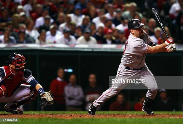 Kevin Youkilis of the Boston Red Sox hits a triple in the seventh inning during Game Five of the American League Championship Series against the...