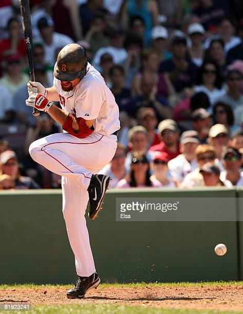Kevin Youkilis of the Boston Red Sox is hit by a pitch from Daniel Cabrera of the Baltimore Orioles on July 13, 2008 at Fenway Park in Boston,...