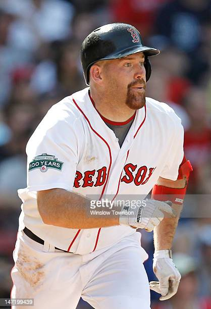 Kevin Youkilis of the Boston Red Sox watches a hit during the interleague game against the Atlanta Braves at Fenway Park on June 23 2012 in Boston...