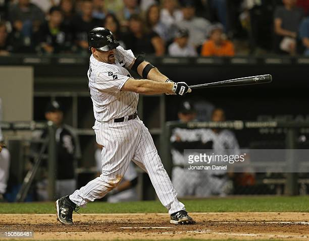 Kevin Youkilis of the Chicago White Sox hits a grand slam home run in the 5th inning against the New York Yankees at US Cellular Field on August 21...