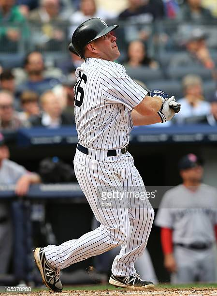 Kevin Youkilis of the New York Yankees follows through on a swing during Opening Day against the Boston Red Sox on April 1 2013 at Yankee Stadium in...