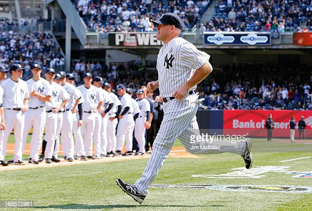 Kevin Youkilis of the New York Yankees is introduced before the Opening Day game against the Boston Red Sox at Yankee Stadium on April 1 2013 in the...