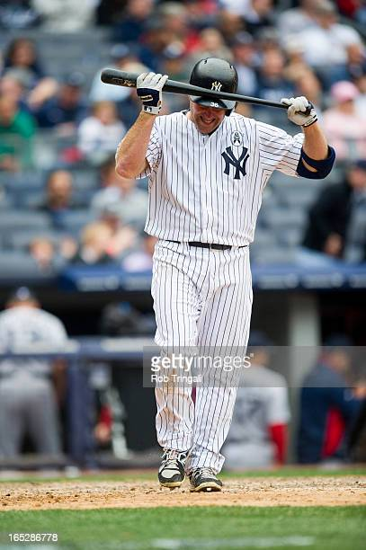 Kevin Youkilis of the New York Yankees reacts after striking out during the Opening Day game against the Boston Red Sox on Monday April 1 2013 at...