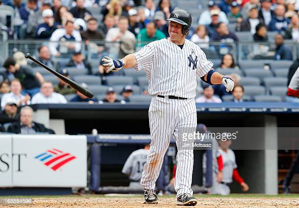 Kevin Youkilis of the New York Yankees reacts after striking out against the Boston Red Sox during Opening Day at Yankee Stadium on April 1 2013 in...