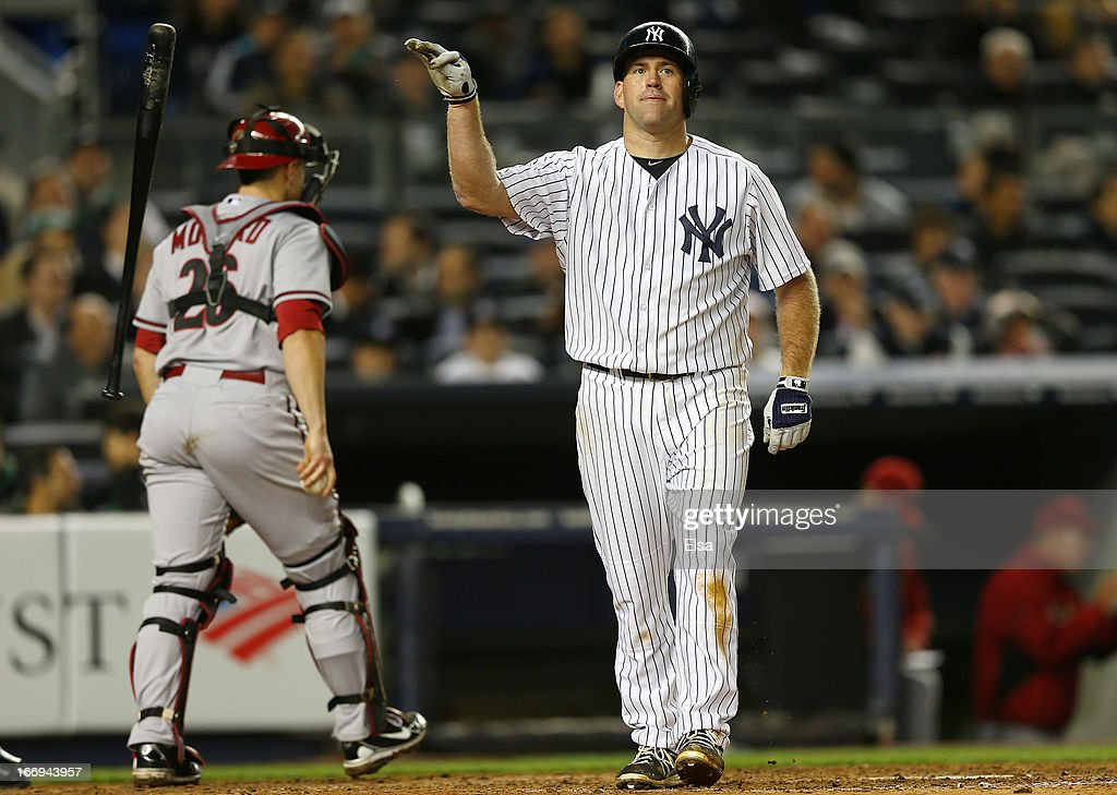 Kevin Youkilis #36 of the New York Yankees reacts after striking out to end the inning as Miguel Montero #26 of the Arizona Diamondbacks walks off the field on April 18, 2013 at Yankee Stadium in the Bronx borough of New York City.