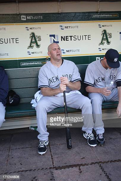 Kevin Youkilis of the New York Yankees sits in the dugout prior to the game against the Oakland Athletics at Oco Coliseum on June 12 2013 in Oakland...