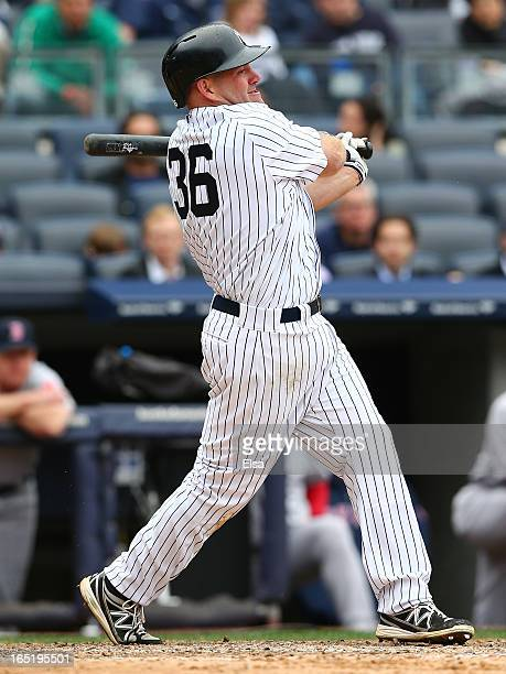 Kevin Youkilis of the New York Yankees takes a swing in the seventh inning against the Boston Red Sox during Opening Day on April 1 2013 at Yankee...