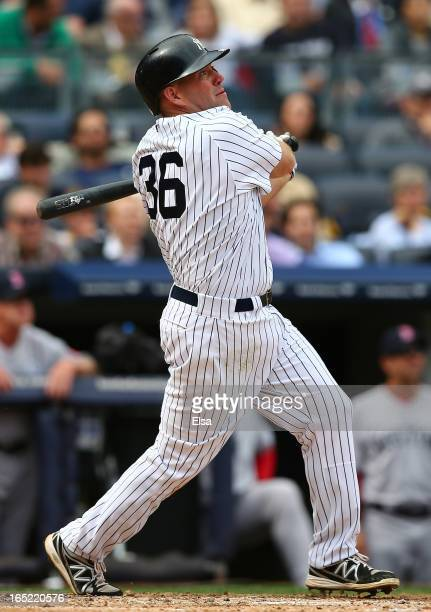 Kevin Youkilis of the New York Yankees watches his hit against the Boston Red Sox during Opening Day on April 1 2013 at Yankee Stadium in the Bronx...