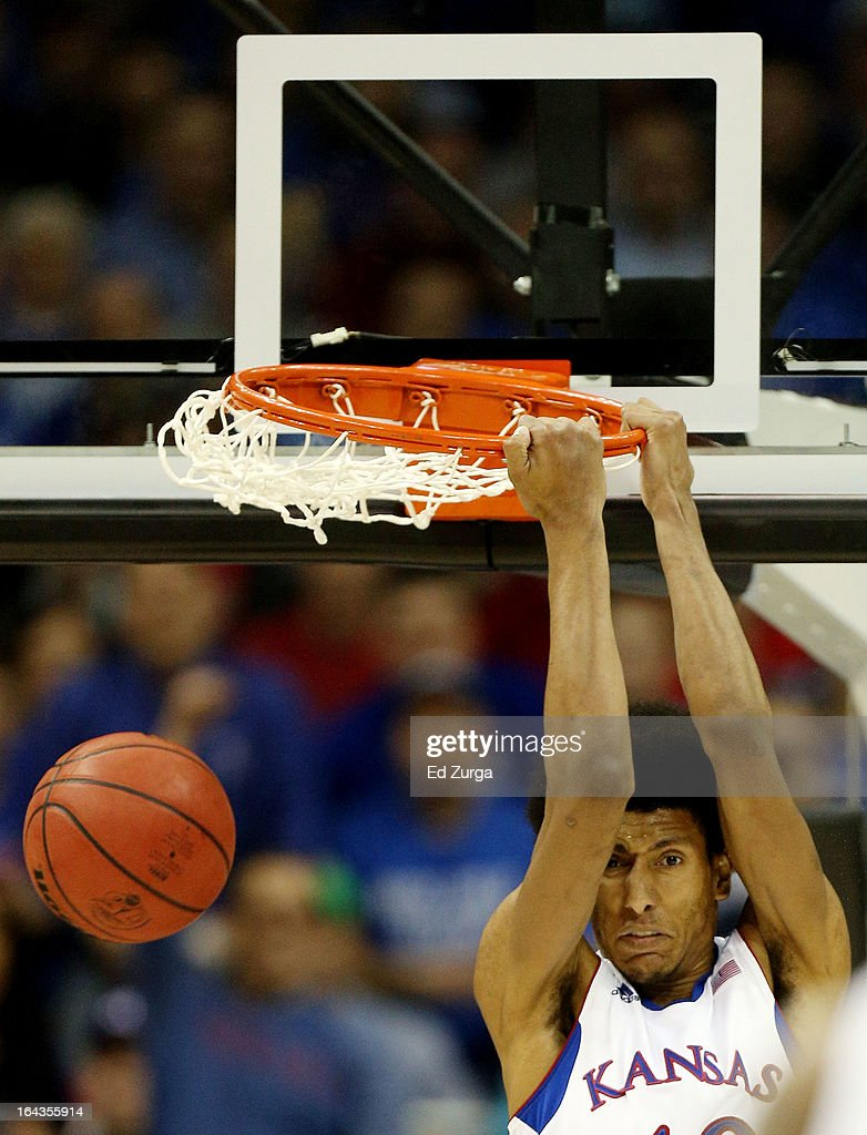 Kevin Young #40 of the Kansas Jayhawks slam dunks against the Western Kentucky Hilltoppers in the second half during the second round of the 2013 NCAA Men's Basketball Tournament at the Sprint Center on March 22, 2013 in Kansas City, Missouri.