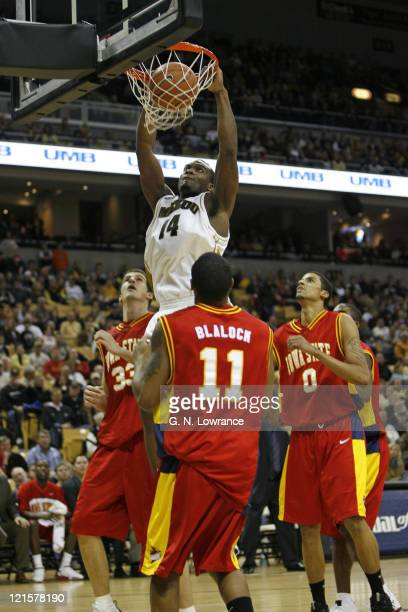 Kevin Young of the Missouri Tigers dunks the ball during 1st half action against the Iowa State Cyclones at Mizzou Arena in Columbia Missouri on...