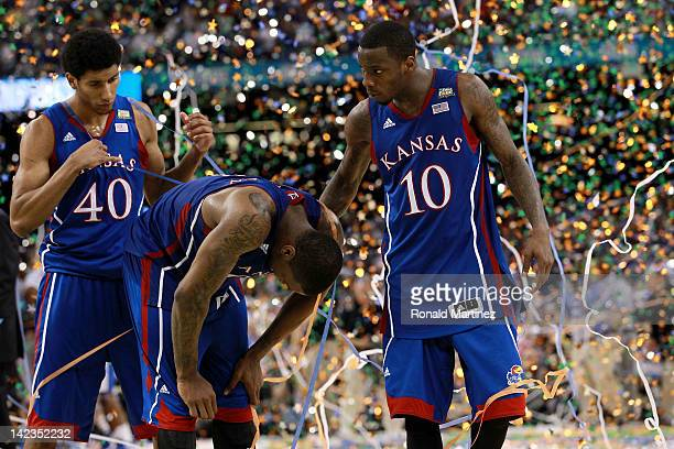 Kevin Young Thomas Robinson and Tyshawn Taylor of the Kansas Jayhawks react after losing to the Kentucky Wildcats 6759 in the National Championship...
