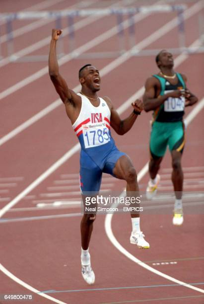 Kevin Young, USA, celebrates winning gold in a new world record time of 46.78 secs
