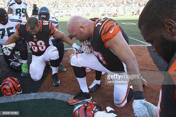 Kevin Zeitler and Andrew Whitworth of the Cincinnati Bengals share a moment in prayer after their game against the Seattle Seahawks at Paul Brown...