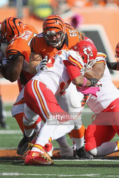 Kevin Zeitler of the Cincinnati Bengals blocks downfield on Derrick Johnson of the Kansas City Chiefs during their game at Paul Brown Stadium on...