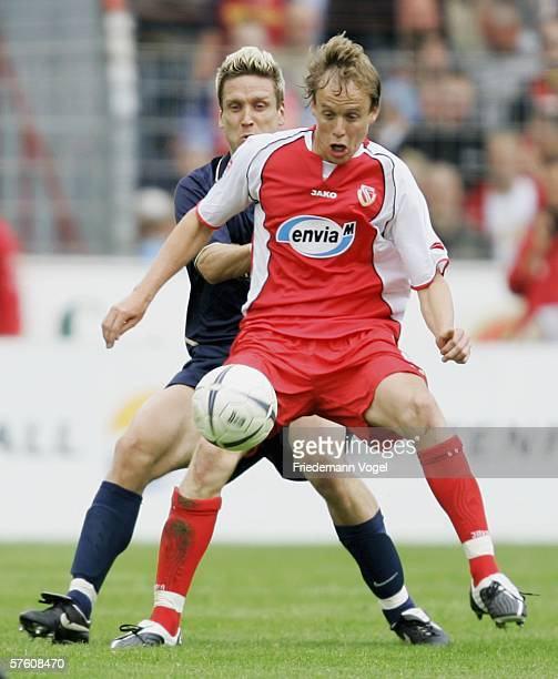 KevinMc Kenna of Cottbus challenges for the ball with Torben Hoffmann of 1860 during the Second Bundesliga match between Energie Cottbus and 1860...